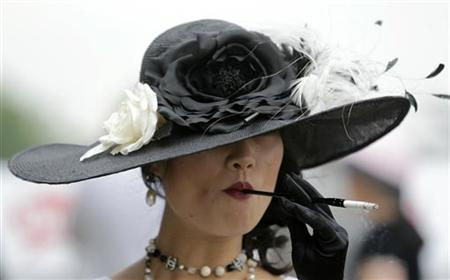 A woman smokes a cigarette at Churchill Downs in Louisville