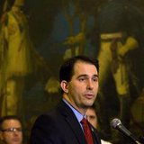Wisconsin State Governor Scott Walker speaks after signing the ceremonial bill at the state Capitol in Madison