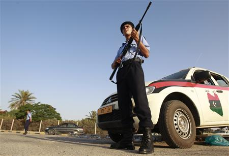 Libyan national security officers stand guard at a street in the rebel-held city of Misrata