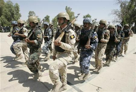 Iraqi soldiers, policemen and Kurdish Peshmerga troops of the Golden Lion forces, a mixed squad put together to secure disputed areas where