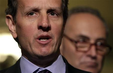 Timothy Geithner speaks to the media next to Charles Schumer after his meeting about the debt limit on Capitol Hill in Washington