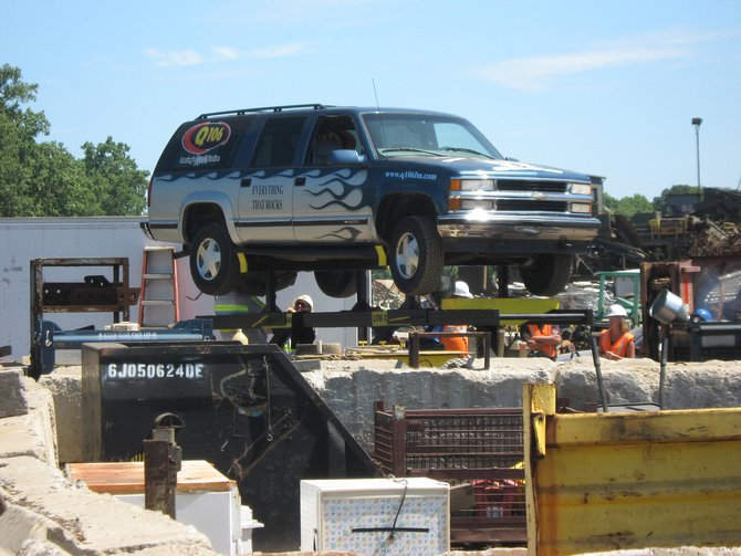 "We ""recycled"" our old Q106 Suburban at Omni Source!  It was a bittersweet moment!  Thank you for stopping out to witness the destruction!"
