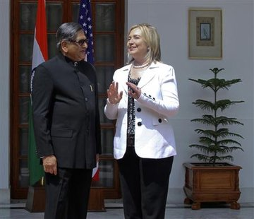 Secretary of State Clinton speaks with India's Foreign Minister Krishna during a photo call before their meeting in New Delhi