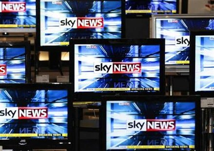 The Sky News logo is seen on television screens in an electrical store in Edinburgh