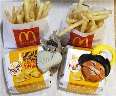 "Two McDonald's Happy Meal with toy watches fashioned after the characters Donkey and Puss in Boots from the movie ""Shrek Forever After"" are"