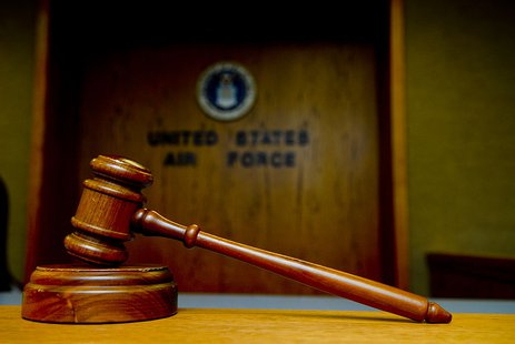 A gavel sits in the Luke Air Force Base courtroom By U.S. Air Force photo/Airman 1st Class Grace Lee [Public domain], via Wikimedia Commons