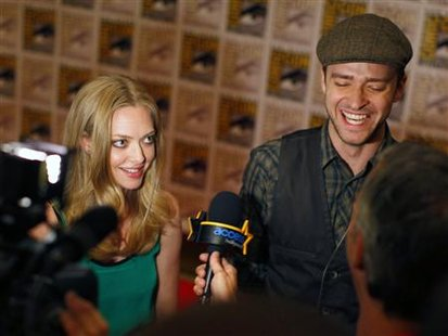 "Cast members Timberlake and Seyfried speak during an interview for their upcoming motion picture ""In Time"" at Comic Con in San Diego"