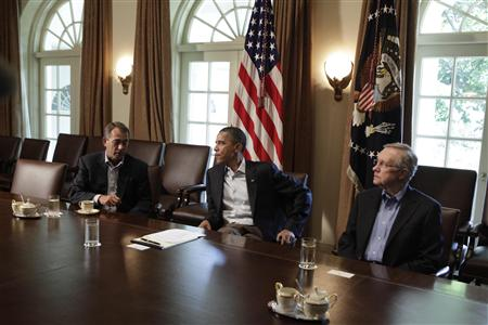 President Barack Obama sits with House Speaker John Boehner and Senate Majority Leader Harry Reid during a meeting in Washington