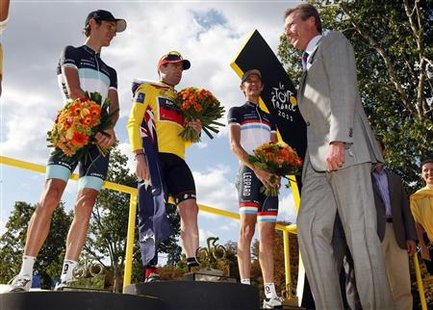 BMC Racing Team's Cadel Evans of Australia is congratulated by Grand Duke Henri of Luxembourg after winning the 98th Tour de France cycling