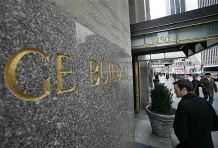A man enters the General Electric building at 1250 Avenue of the Americas, also known as 30 Rockefeller Plaza in New York