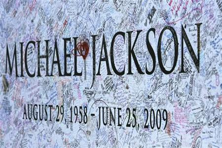A section of a large Michael Jackson poster is pictured outside Staples Center in Los Angeles
