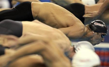 Phelps of the U.S. gets ready for the men's 200m freestyle semi-final at the 14th FINA World Championships in Shanghai