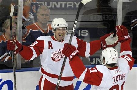 Red Wings' Draper and Tatar celebrate goal against Oilers during their NHL hockey game in Edmonton