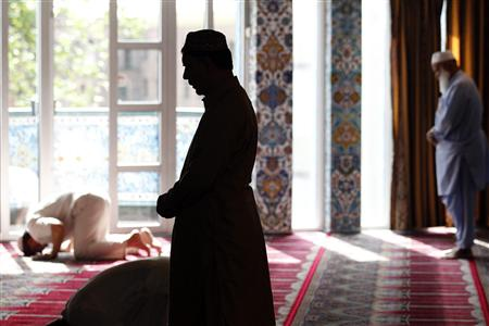 Muslim men pray at the World Islamic Mission Mosque in Oslo