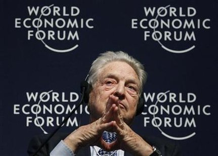Soros Fund Management Chairman, Soros, attends a session at the World Economic Forum in Davos