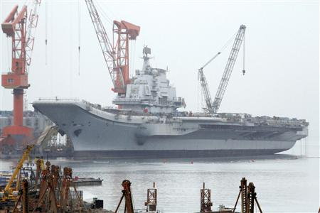 "File picture of a vessel at a port in Dalian, reported to be the Ukrainian-made aircraft carrier ""Varyag"" bought by China"