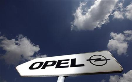 A sign indicates the way towards the headquarters of German car manufacturer Opel in Ruesselsheim