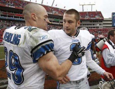 Detroit Lions safety John Wendling (29) congratulates place kicker Dave Rayner (3) after he kicked a field goal at the end of regulation and one in overtime to defeat the Tampa Bay Buccaneers in Tampa, Florida December 19, 2010. REUTERS