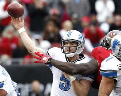 Detroit Lions quarterback Drew Stanton (5) gets a pass away for a first down in overtime against the Tampa Bay Buccaneers during their NFL football game in Tampa, Florida December 19, 2010. REUTERS