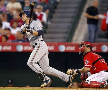 Milwaukee Brewers' Ryan Braun follows through to hit a grand slam home run as the Los Angeles Angels catcher Mike Napoli (R) also watches in the third inning of their MLB interleague baseball game in Anaheim, California June 14, 2010. REUTERS