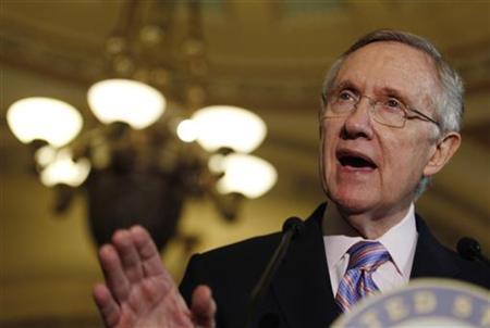 Senate Majority Leader Harry Reid speaks to the press during debt reduction talks on Capitol Hill in Washington