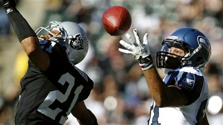 Oakland Raiders Nnamdi Asomugha breaks up a pass intended for Seattle Seahawks Golden Tate during their NFL football game in Oakland