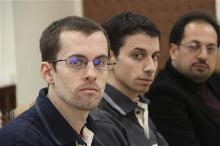 American hikers Shane Bauer (L) and Josh Fattal and their translator attend the first session of their trial in Tehran