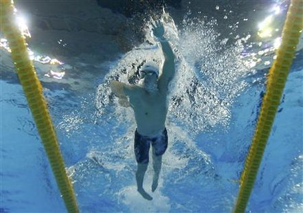 China's Sun competes in the men's 1500m freestyle heats at the 14th FINA World Championships in Shanghai