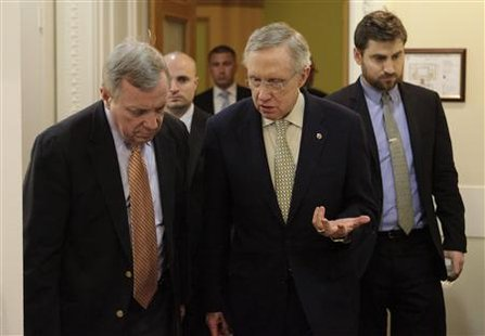 Senate Majority Leader Harry Reid and and Senate Majority Whip Dick Durbin arrive at a news conference in Washington