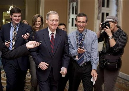 US Senate Minority Leader McConnell walks to the Senate Chamber after a tentative agreement had been reached on the debt ceiling crises on C