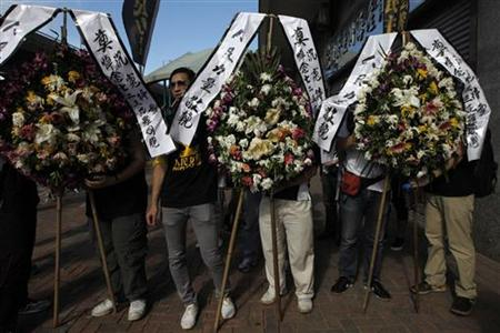 Wreaths are displayed in Hong Kong during a ceremony to remember the victims of the Wenzhou's train accident