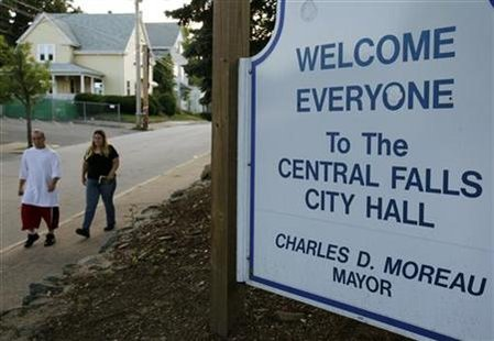 Pedestrians pass City Hall in Central Falls