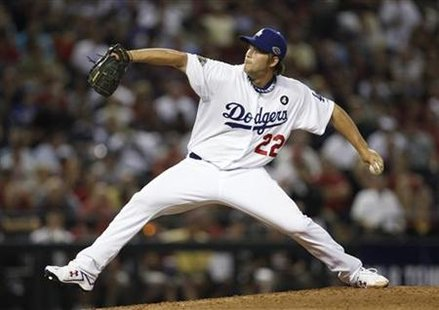 National League's Kershaw throws against American League during Major League Baseball's All-Star Game in Phoenix
