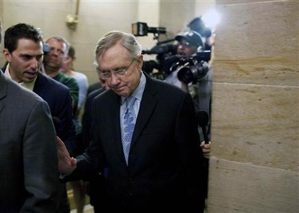 Harry Reid speaks to reporters as he leaves after meeting with House Democratic leadership on the debt ceiling crises on Capitol Hill in Was