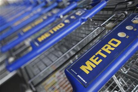 Shopping carts of Germany's biggest retailer Metro AG are lined up at a Metro cash and carry market in St. Augustin