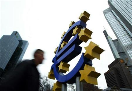 File photo of pedestrian walking by a huge Euro logo in front of the European Central Bank in Frankfurt