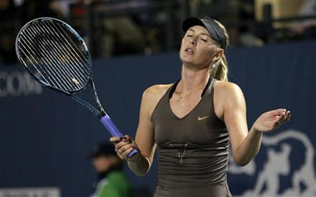 Russia's Maria Sharapova reacts during her Stanford Classic tennis match against Serena Williams of the U.S. in Stanford