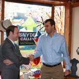 Republican Congressman Justin Amash of Michigan shakes hands with Lieutenant Governor Brian Calley.  Photo courtesy of Amash on Facebook.