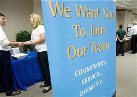 "Jobseekers attend a ""Hiring our Heroes"" job fair aimed at out-of-work military veterans in Ashburn"