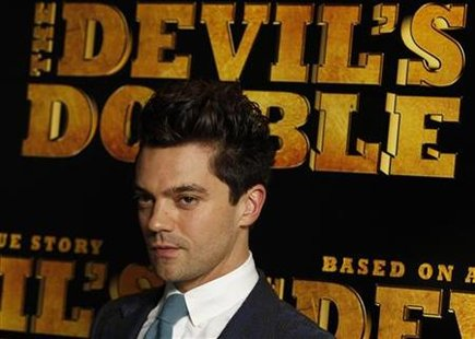 "Actor Dominic Cooper poses for photographers at the British Premiere of ""The Devil's Double"", in London"