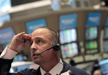 A trader looks on as he works on the floor of the New York Stock Exchange