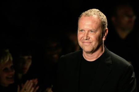 Designer Michael Kors smiles on the runway during New York fashion week