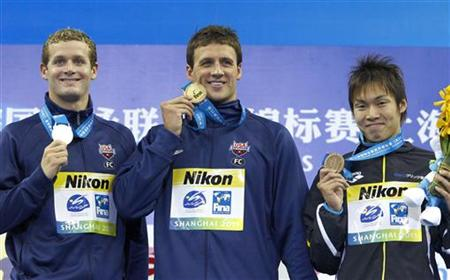 Lochte and Clary and Horihata display their medals during an award ceremony after men's 400m individual medley final at 14th FINA World Cham