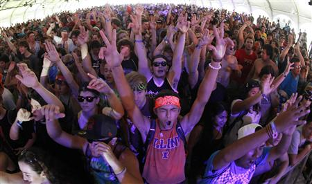 Music fans listen to Lady D perform at the Lollapalooza music festival in Grant Park in Chicago