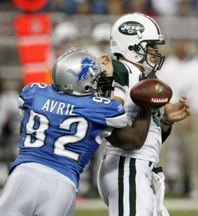 Detroit Lions defensive end Cliff Avril (L) strips the ball from New York Jets QB Mark Sanchez (R) during the first half of their game in Detroit on November 7, 2010. REUTERS