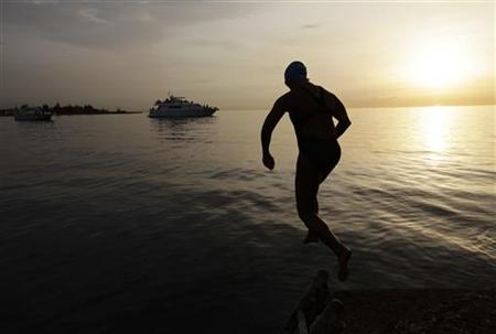 U.S swimmer Diana Nyad jumps into the Straits of Florida in Havana