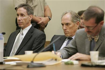 Polygamist leader Warren Jeffs sits with his defense team as they listen to Judge James L. Shumate's sentence in the fifth district court in