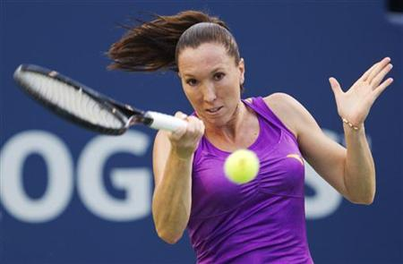 Jelena Jankovic of Serbia returns a shot to Julia Goerges of Germany during their match at the Rogers Cup women's tennis tournament in Toron