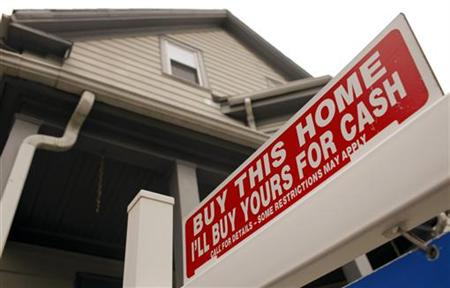 "The sign on a property for sale in Somerville, Massachusetts reads ""Buy This Home I'll Buy Yours For Cash"""