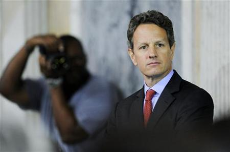 Geithner waits to go onstage at the Women in Finance Symposium at the Treasury Department in Washington